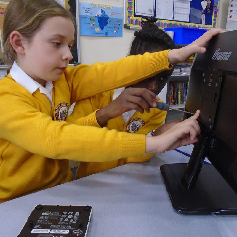 Children assembling IT equipment